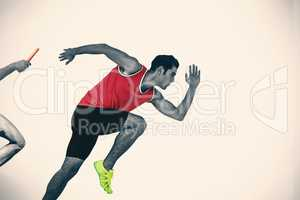 Composite image of confident male athlete running from starting