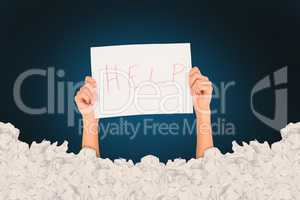 Composite image of woman holding help written on paper