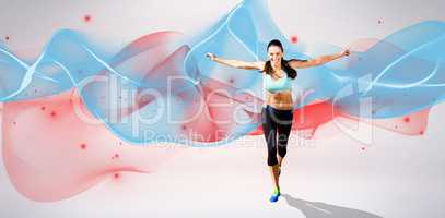 Composite image of happy sportswoman is raising arms
