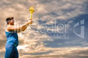 Composite image of low angle view of sportsman holding a cup