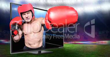 Composite image of boxer punching against black background