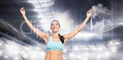 Composite image of portrait of happy sportswoman is raising arms