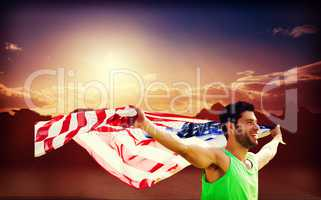 Composite image of happy sportsman holding a american flag