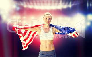 Composite image of portrait of smiling sportswoman posing with a