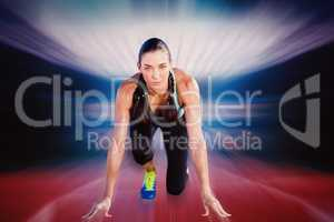 Composite image of sporty woman in the starting block