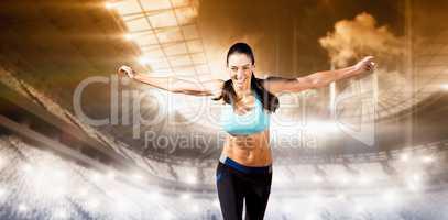 Composite image of happy sportswoman is raising arms