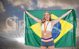 Composite image of athlete posing with gold medal after victory