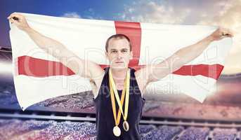 Composite image of athlete with olympic gold medal around his ne