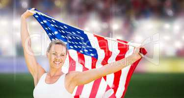 Composite image of portrait of happy sportswoman posing with an