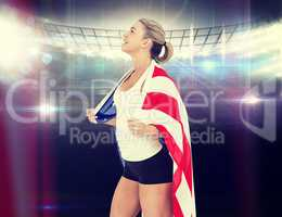 Composite image of female athlete with american flag on her shou
