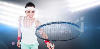 Composite image of female athlete playing badminton