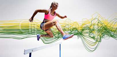 Composite image of sporty woman jumping a hurdle