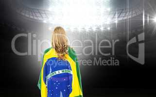 Composite image of athlete with brazilian flag wrapped around hi