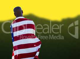 Man wearing american flag against blurred mountains
