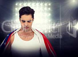 Composite image of athlete with american flag wrapped around his