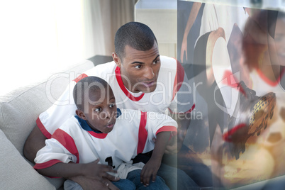 Composite image of father and son are watching sport on televisi