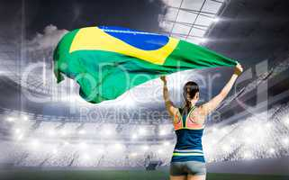 Composite image of rear view of sportswoman raising a brazilian
