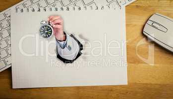 Composite image of hand holding alarm clock