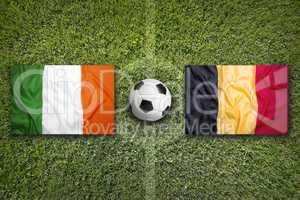 Ireland vs. Belgium flags on soccer field