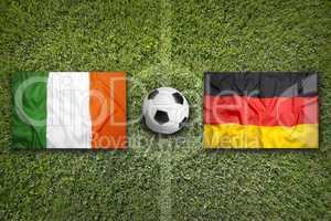 Ireland vs. Germany flags on soccer field