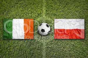 Ireland vs. Poland flags on soccer field