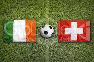 Ireland vs. Switzerland flags on soccer field