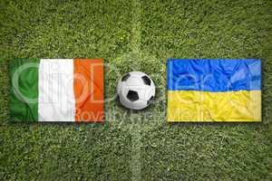 Ireland vs. Ukraine flags on soccer field