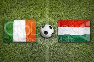Ireland vs. Hungary flags on soccer field