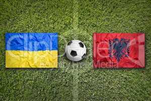 Ukraine vs. Albania flags on soccer field