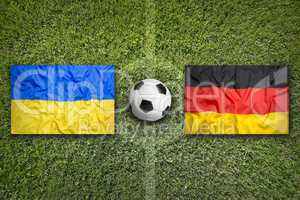 Ukraine vs. Germany flags on soccer field