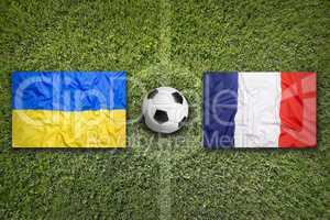 Ukraine vs. France flags on soccer field