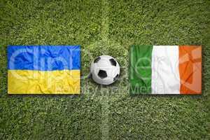 Ukraine vs. Ireland flags on soccer field