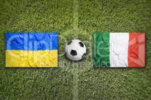 Ukraine vs. Italia flags on soccer field