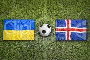 Ukraine vs. Iceland flags on soccer field