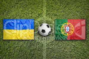 Ukraine vs. Portugal flags on soccer field