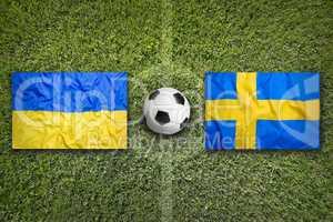 Ukraine vs. Sweden flags on soccer field