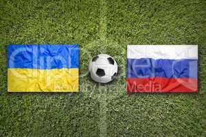Ukraine vs. Russia flags on soccer field