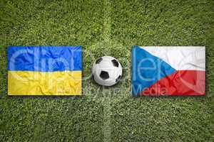 Ukraine vs. Czech Republic flags on soccer field