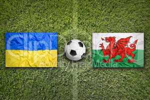 Ukraine vs. Wales flags on soccer field