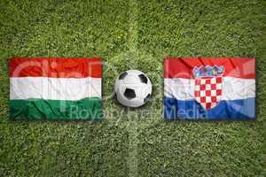 Hungary vs. Croatia flags on soccer field