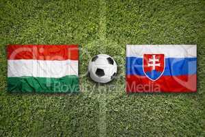 Hungary vs. Slovakia flags on soccer field