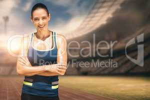 Composite image of sportswoman posing and smiling on a white bac
