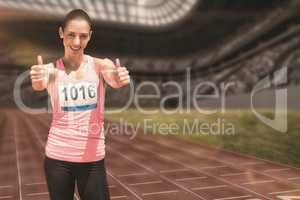 Composite image of athlete woman smiling with thumbs up