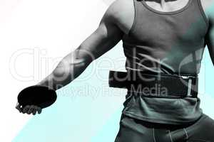 Composite image of close up on sportsman chest practising discus
