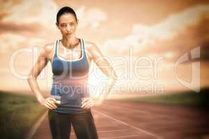 Composite image of sportswoman posing on a white background