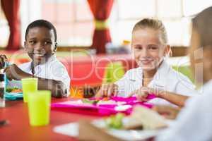Children having lunch during break time in school cafeteria