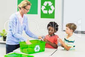Teacher and kids discussing about recycle