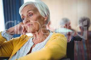 Senior woman in wheelchair look worried