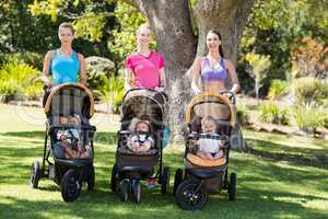 Women standing with the baby stroller