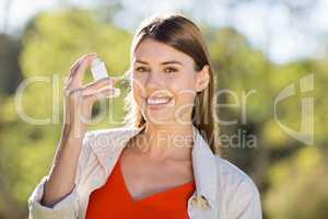 Portrait of beautiful woman using asthma inhaler